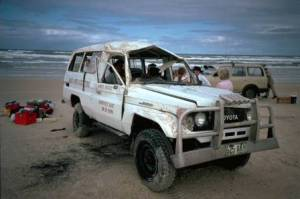 Damaged 4WD on the beach.