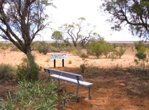 Rest spot and sign on Lake Bindegolly circuit walk.