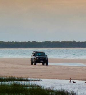 Beaches have hazards including washouts and exposed rocks. Stay alert when driving. Photo: Queensland Government.