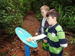 Image of 2 children having fun on the Lake Eacham children's walk.