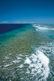 Aerial image of ribbon reefs which form a broken barrier along the edge of the continental shelf, near Lizard Island, Queensland.