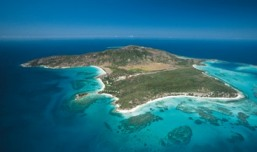 Lizard Island, Queensland, has a dry environment and is clad in grasslands and open woodlands. Photo: Tourism Queensland.