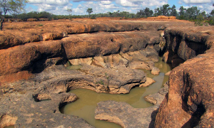 Rugged gullies and waterholes invite exploration. Take care near cliff edges and around slippery rocks. Photo: © Queensland Government