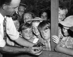 Baby platypus being shown to school children. Photograph from the David Fleay Natural history collection. Photo: David Fleay Trustees.