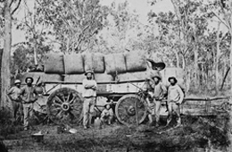 Wool teamsters with a loaded wagon of wool bales on the road to port, 1869. Photo courtesy of the State Library of Queensland