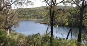 Karboora (deep silent pool) is an area of special cultural significance to the Quandamooka people. Please respect their culture by not swimming in the lake. Photo: Queensland Government.