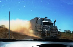 Passing heavy vehicles raises dust clouds and reduces visibility.