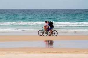 Cycling is a great way to get around and see the sites of Minjerribah. Photo: Queensland Government.