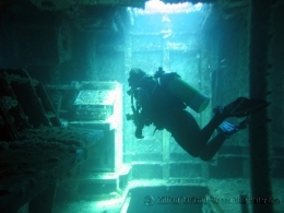 A diver explores the operations room inside the wreck. Photo courtesy of Gillian Davidson, Noosa Blue Water Dive.