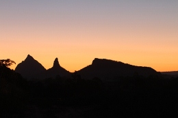 The Glass House Mountains silhouetted against the setting sun, from Moreton Bay. Photo: Ross Naumann, QPWS volunteer.