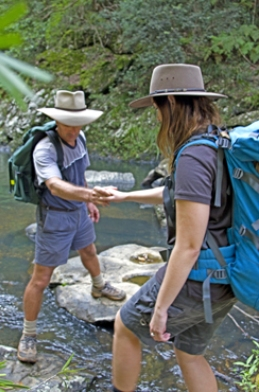 Rock-hopping across Booloumba Creek on the final stages of the Conondale Range Great Walk. Photo: Robert Ashdown, Queensland Government.