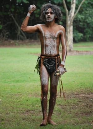 Travis Page, the dance group's Yawar-nuba (songman), tells the story of wuruma (brahminy kite) dance. Photo: Matt Lowry, Queensland Government