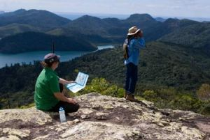 Walkers enjoy the amazing view from Whitsunday Peak. Photo: J Heitman.