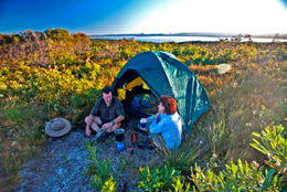 Brahminy walkers' camp located on low coastal heath, with sweeping views of Lake Cootharaba to the west.