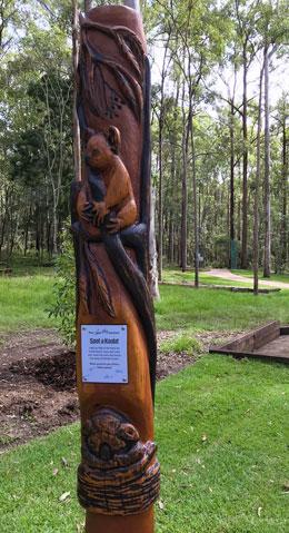 A carved koala statue.