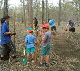 Fraser Coast Mountain Bike Club members working together to build the Toogoom mountain bike trails.