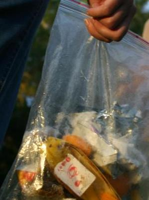 A zip-lock bag is ideal for carrying out all food scraps and rubbish. Photo: Adam Creed, Queensland Government.